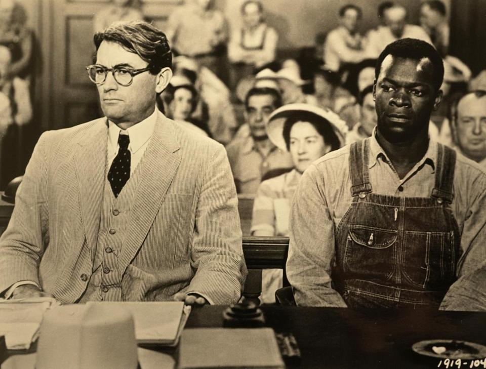 "MOVIES: Actor Gregory Peck (L) appears with actor Brock Peters in a scene from the 1962 film ""To Kill a Mockingbird."" Peck died at age 87 late June 11, 2003 at his home in Los Angeles, with his wife of 48 years, Veronique, at his side. B&W ONLY NO COMMERCIAL SALES REUTERS/HO Universal Pictures ORG XMIT: LOA04D 05golden"