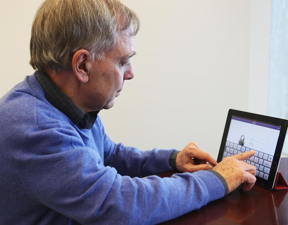 Carbonite's David Friend, shown logging on to his firm's site, sees his company struggling in New York.
