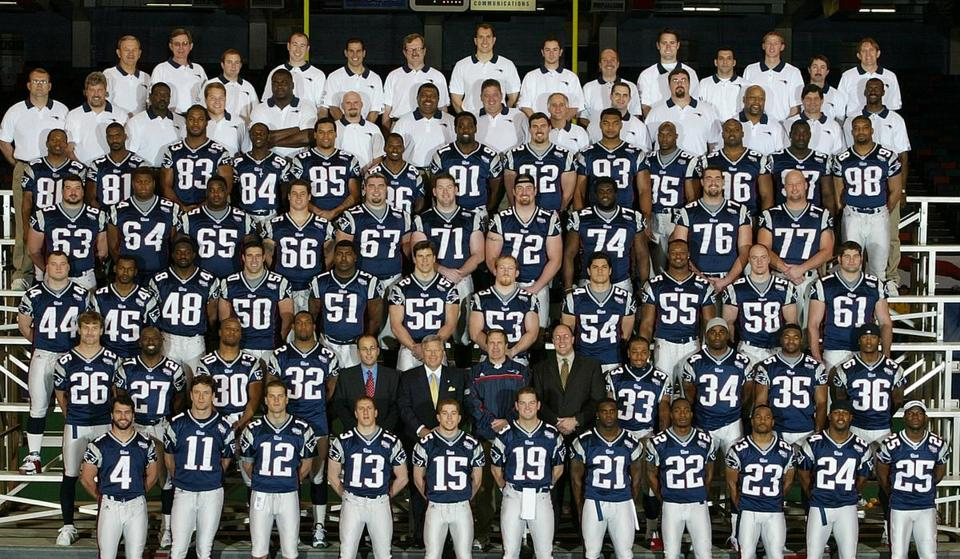 A team photo of the Super Bowl XXXVI Champion New England Patriots.