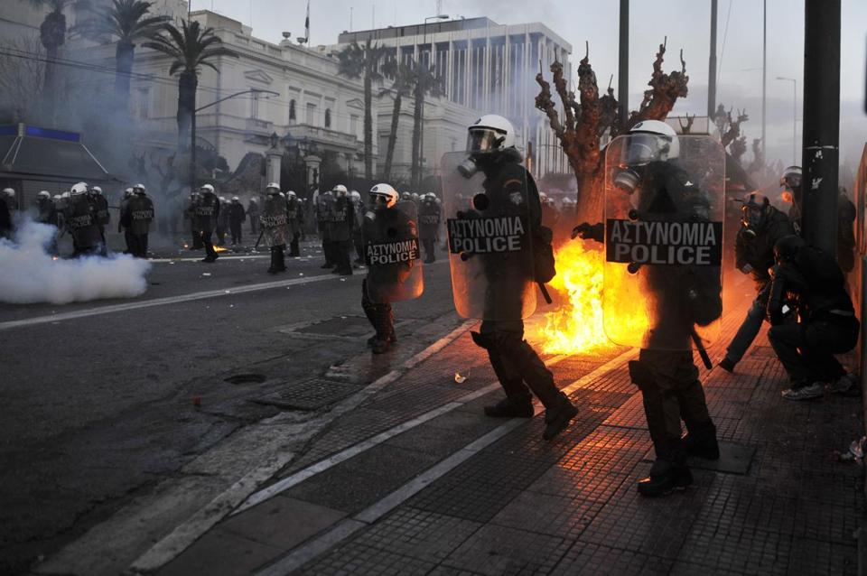Fifty police officers were injured and at least 55 protesters were hospitalized during rioting in Athens yesterday.