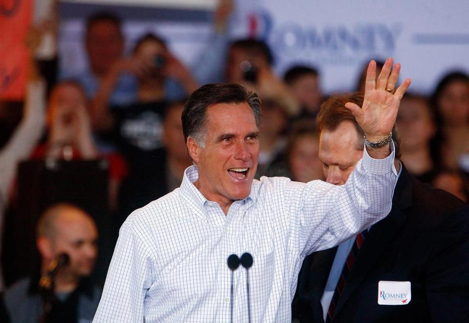 MESA, AZ - FEBRUARY 13: Republican presidential candidate, former Massachusetts Gov. Mitt Romney waves to the crowd at a Get out the Vote Rally February 13, 2012 in Mesa, Arizona. Romney spoke to a crowd of more than 2,000 people, and is the first contender to visit the state prior to the primary on February 22, 2012. (Photo by Eric Thayer/Getty Images)
