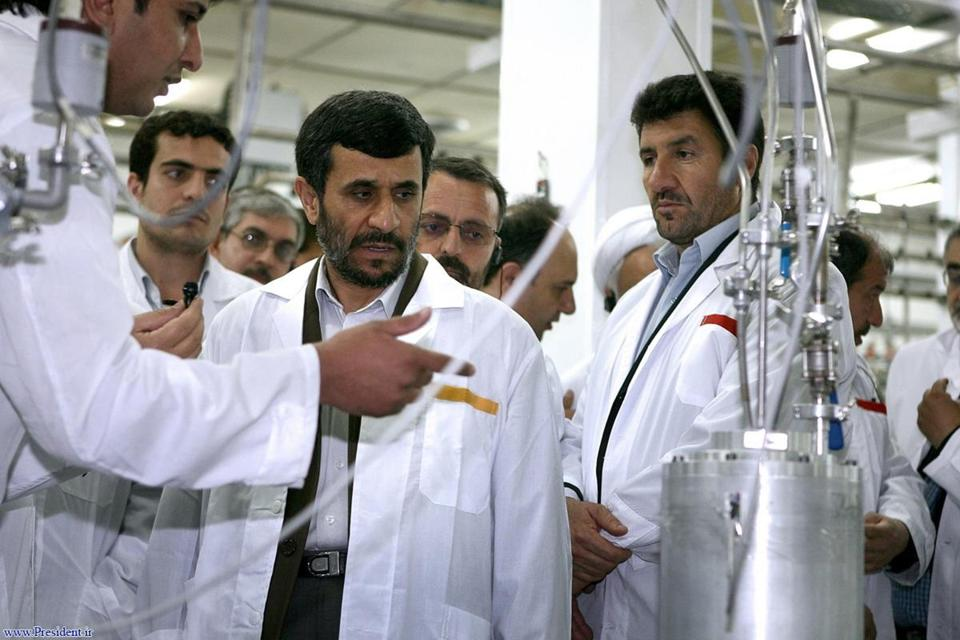 In this April 8, 2008, photo released by the Iranian President's Office, Iranian President Mahmoud Ahmadinejad, center, listened to a technician during a visit of the Natanz Uranium Enrichment Facility some 200 miles south of the capital Tehran, Iran.