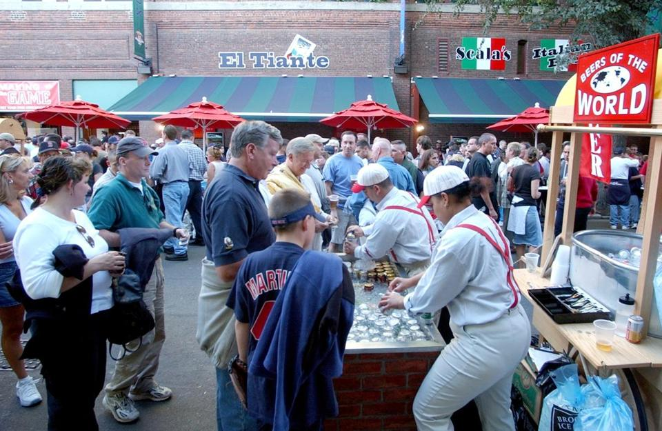 Fans lined up for refreshments in the Red Sox' new game-day pavilion on Yawkey Way.