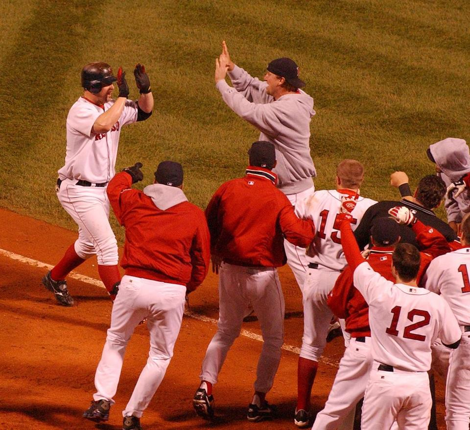 Teammates mobbed Troy Nixon after his game-winning blast in the 11th inning.