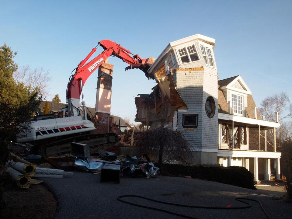 After an 18-year legal battle that pitted neighbor against neighbor, this house at 74 Rubier Road in Marblehead was razed today. The neighbors said the house, valued at $1.5 million, reduced their access to light, views and air.