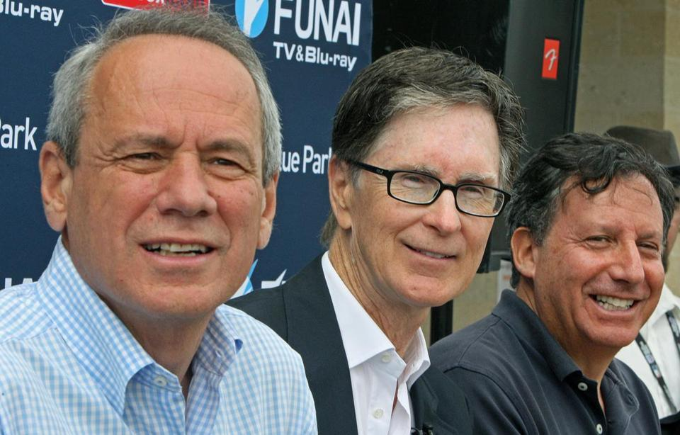 The Red Sox brass — (from left) Larry Lucchino, John Henry, and Tom Werner — got some face time in spring camp yesterday.