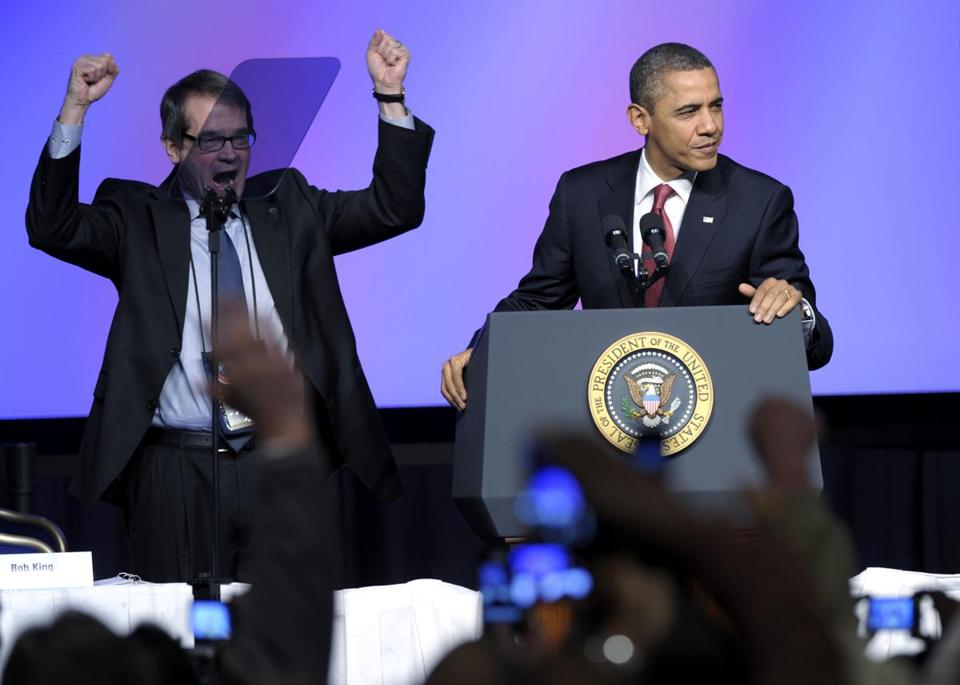 United Auto Workers president Bob King (left) cheered as President Barack Obama spoke at the UAW conference in Washington today.
