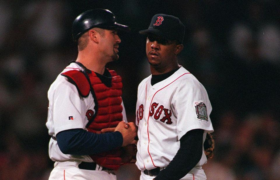 Jason Varitek congratulated Pedro Martinez after they closed out a win on Sept. 21, 1999.