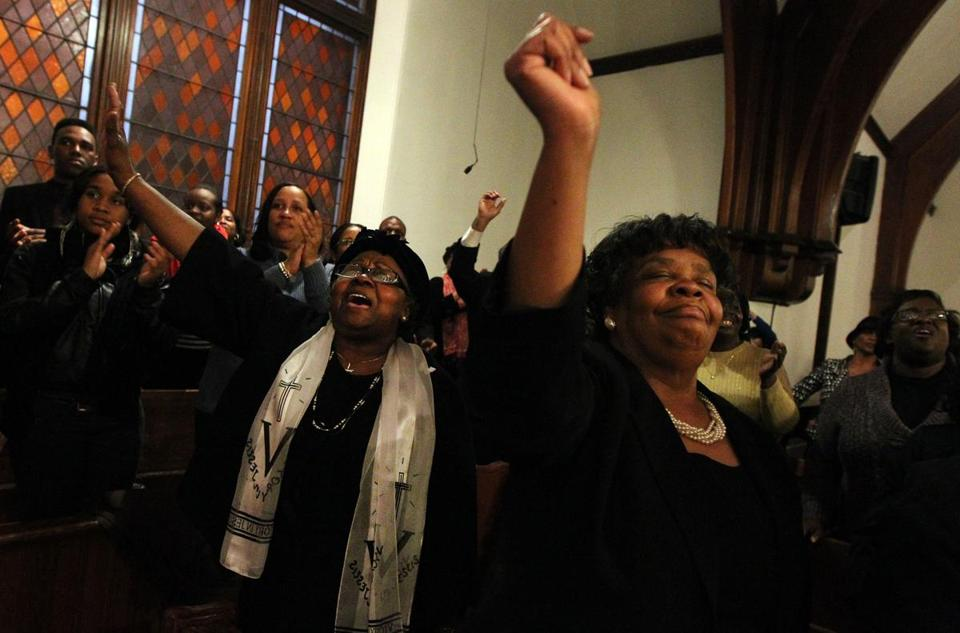 Rev. Gracie Redfearn  and Rev. Dr. Gloria Cater of the Charles Street AME Church attended a rally Sunday evening to protest OneUnited Bank's threatened foerclosure of the church.