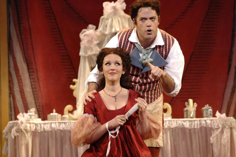 Soprano Sarah Coburn as Rosina and baritone Jonathan Beyer as Figaro in Boston Lyric Opera's ''The Barber of Seville.''