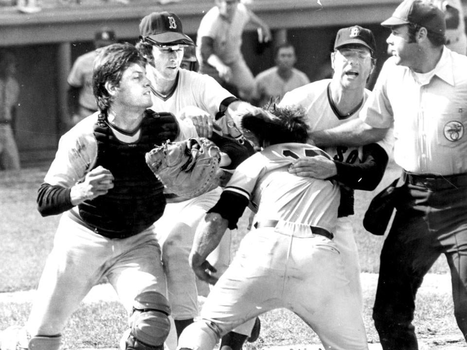 Carlton Fisk, left, and Thurmon Munson engaged in a fight at home plate.