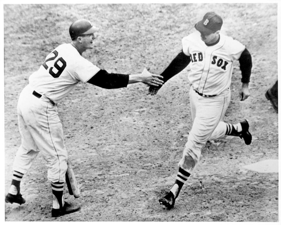 Ted Williams accepted congratulations by Jim Pagliaroni after homering in his final at-bat.