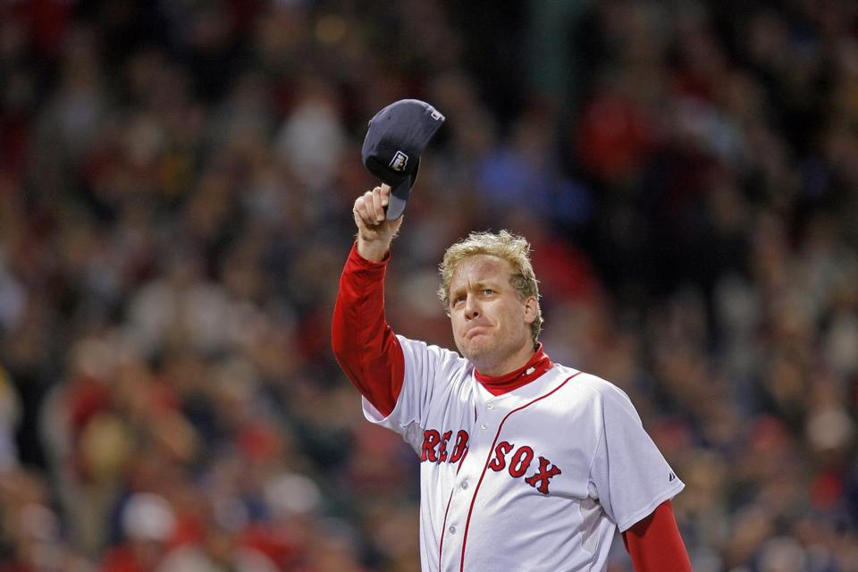 An emotional Curt Schilling tipped his cap to the crowd as he left the game the sixth inning.