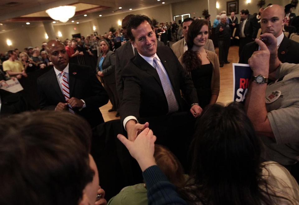 Rick Santorum shook hands with supporters at a rally in Bellevue, Wis., Saturday.