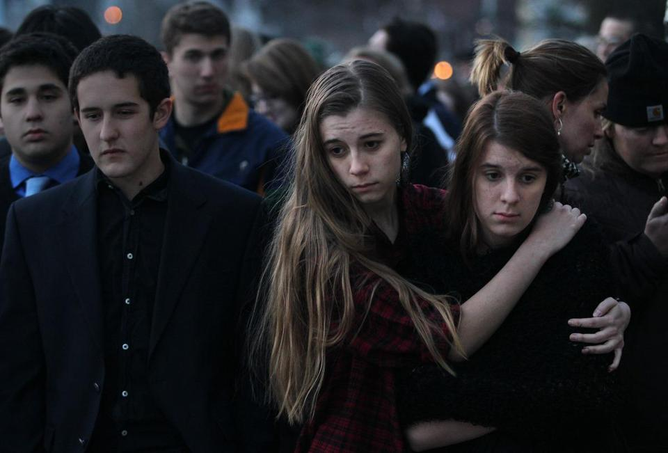 Sisters Jordan (center) and Katrina Dekett joined a candlelight vigil at St. Johnsbury Academy last year in memory of teacher Melissa Jenkins, who worked at the school.