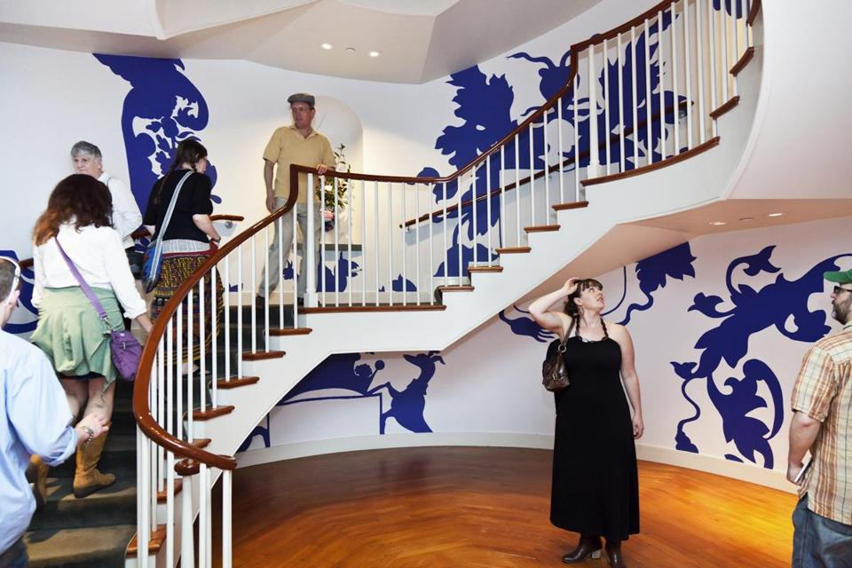 Borrowing from coats of arms European nobles commissioned from Chinese shops on porcelain dinner services, Michael Lin has painted ornamental designs wheeling up a cylindrical stairwell at the museum.