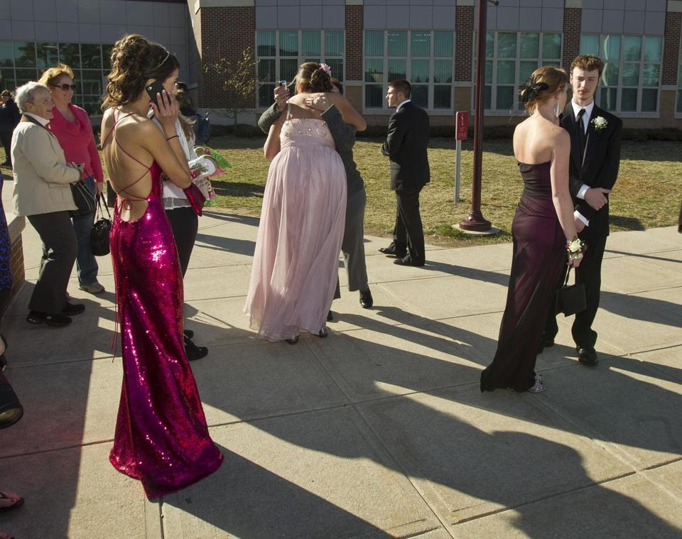 Students arrived at Silver Lake Regional High School Friday for the junior prom. School officials decided to have the event as planned, despite the fact that earlier, four students were injured in a crash with a school bus