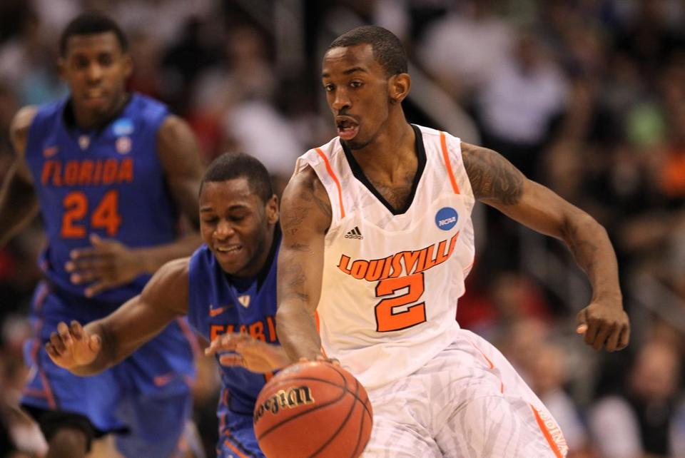 Russ Smith of the Louisville Cardinals moved the ball against Erving Walker of the Florida Gators on March 24.