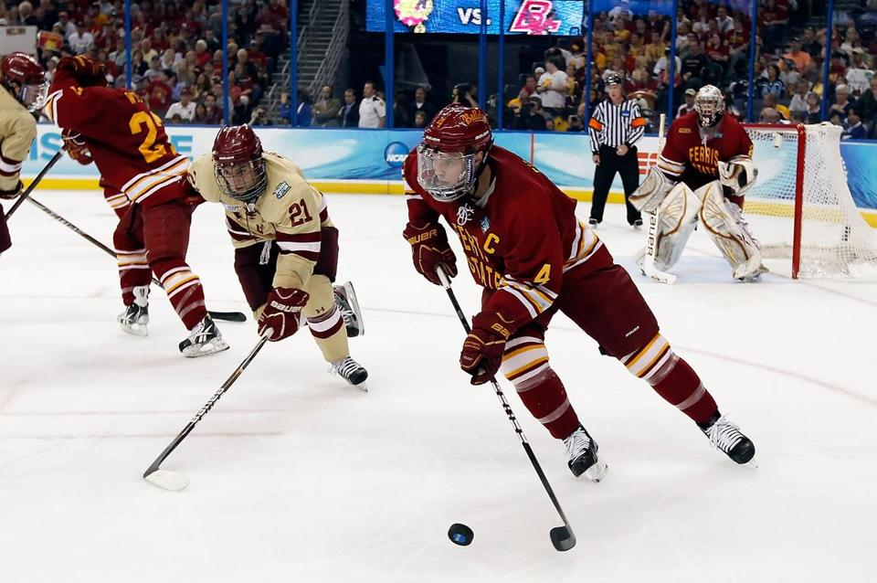 Defenseman Chad Billins of the Ferris State Bulldogs advanced the puck against the Boston College Eagles during the NCAA Division 1 Men's Hockey Championship Game.