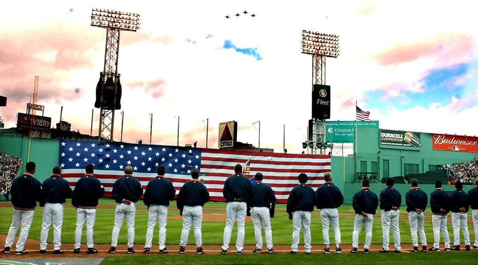 The Red Sox draped a large American flag over the left field wall for the season opener.