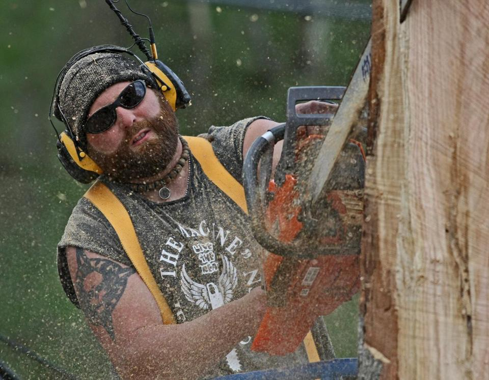 Medway chainsaw artist Jesse Green's work has drawn legions of fans viewing his bat sculpture in Plainville.