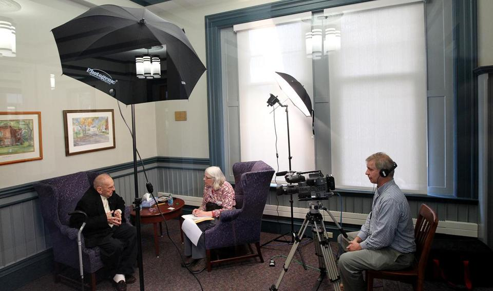 Frank Rines Jr., 92, was interviewed by Maureen Sullivan at Natick's Morse Institute Library, with Dan McDermott videotaping his stories.