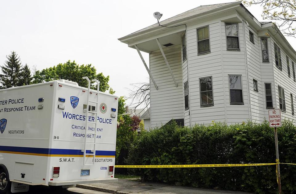 A baby found in a car seat in Lovell Street in Worcester Saturday led police to this house, where a man was found dead and two women seriously injured in an apartment.