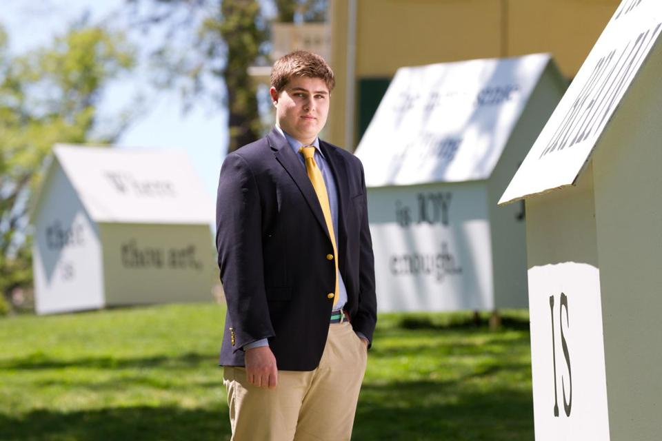 Deerfield Academy student Peter Krasznekewicz, 17, stands among some of the 34 houses in his public art installation at the Emily Dickinson Museum.