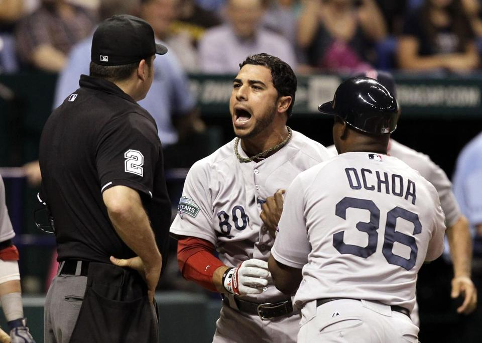 Mike Aviles had to be restrained by first base coach Alex Ochoa after being called out on strikes by home plate umpire Dan Bellino on Thursday.