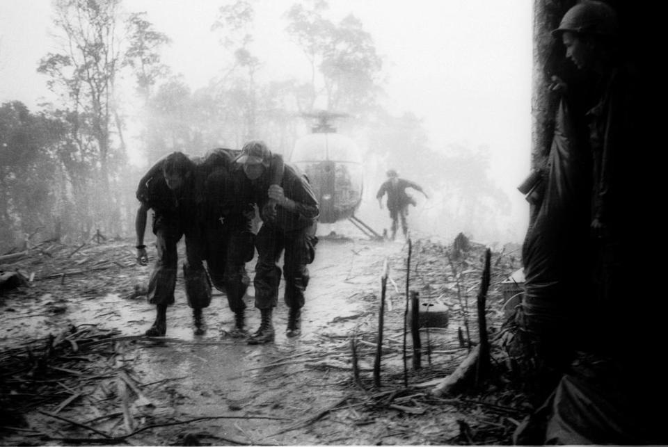 A wounded US paratrooper is helped through a blinding rainstorm in 1969 by medics during the 10-day battle for Hamburger Hill. The more than 1.6 million troops back from the wars in Afghanistan and Iraq will join more than 20 million others from previous wars.