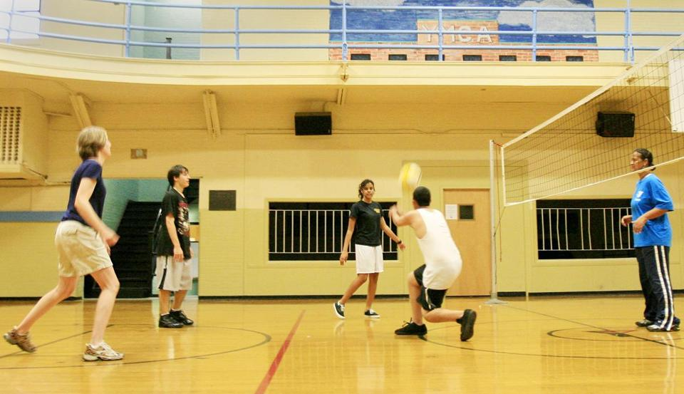 Players enjoy a game of co-ed recreational volleyball at the Old Colony YMCA in Brockton.