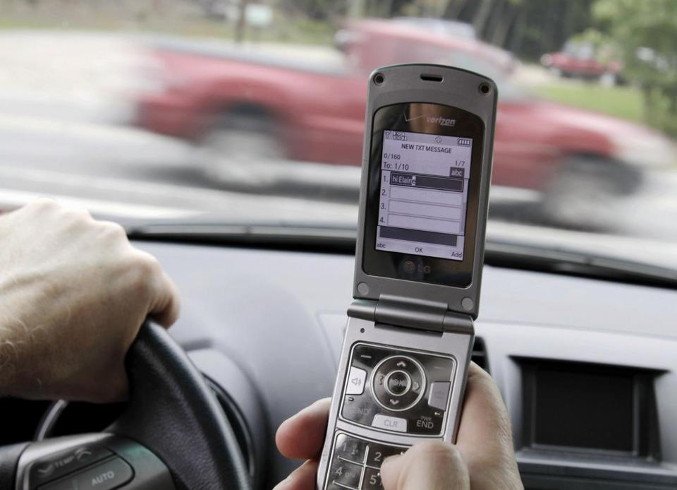How do rules about cellphone use in cars vary by state?