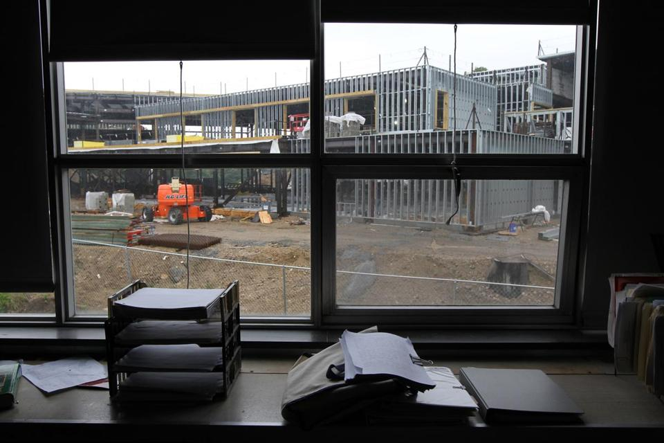The new Maynard High School under construction as seen through the window of a current classroom in the existing high school.