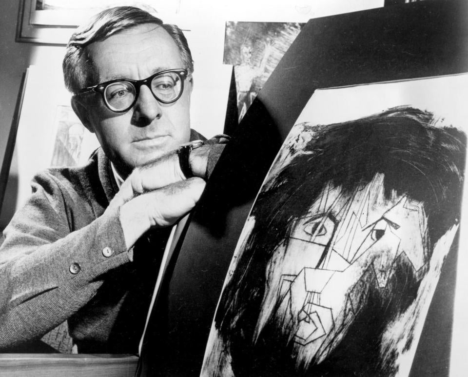 Ray Bradbury with an illustration that a student made to depict one of his characters.