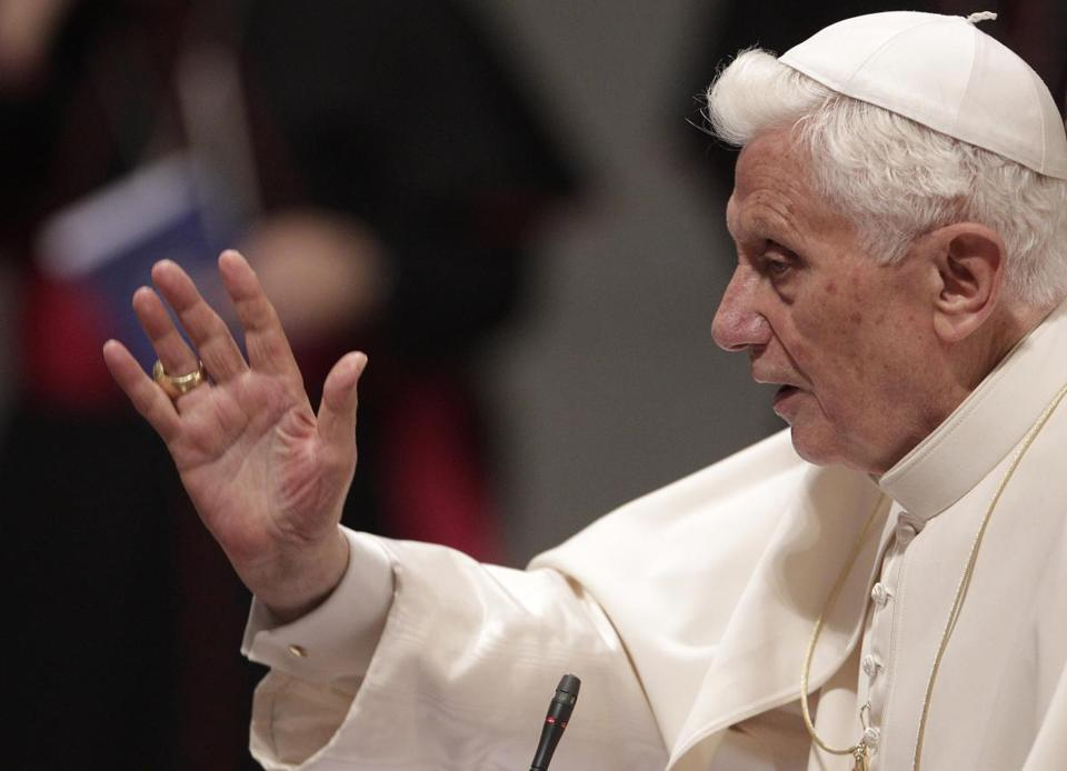Pope Benedict XVI delivered his blessing during the opening day of Rome's dioceses ecclesiastic meeting at St. John at the Lateran Basilica in Rome on Monday.
