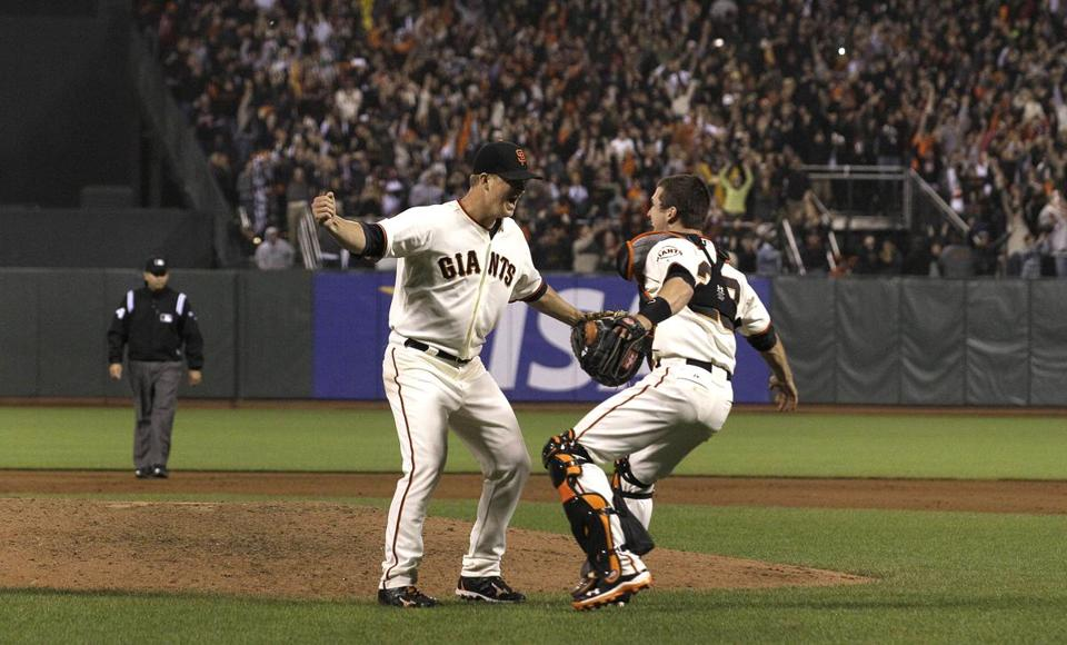 Matt Cain, celebrated with catcher Buster Posey after the final out of his perfect game.