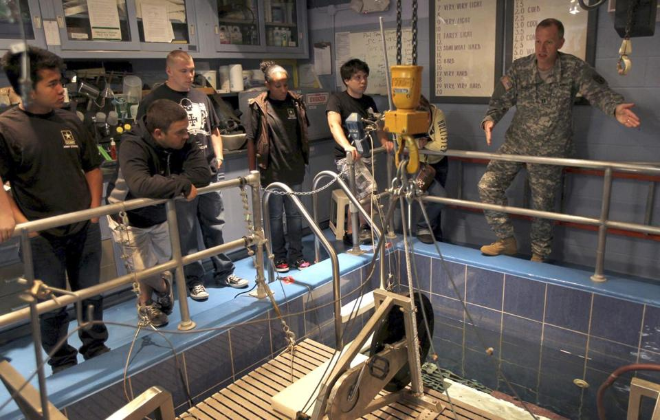 Captain David DeGroot gives future soldiers a tour of the water immersion lab at the Natick Soldier Systems Center.