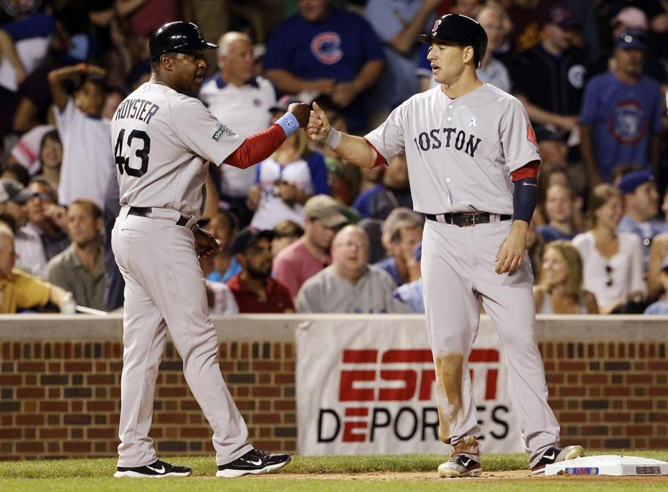 Ryan Kalish, right, got a hand from Red Sox third base coach Jerry Royster in the seventh after hitting an RBI single.
