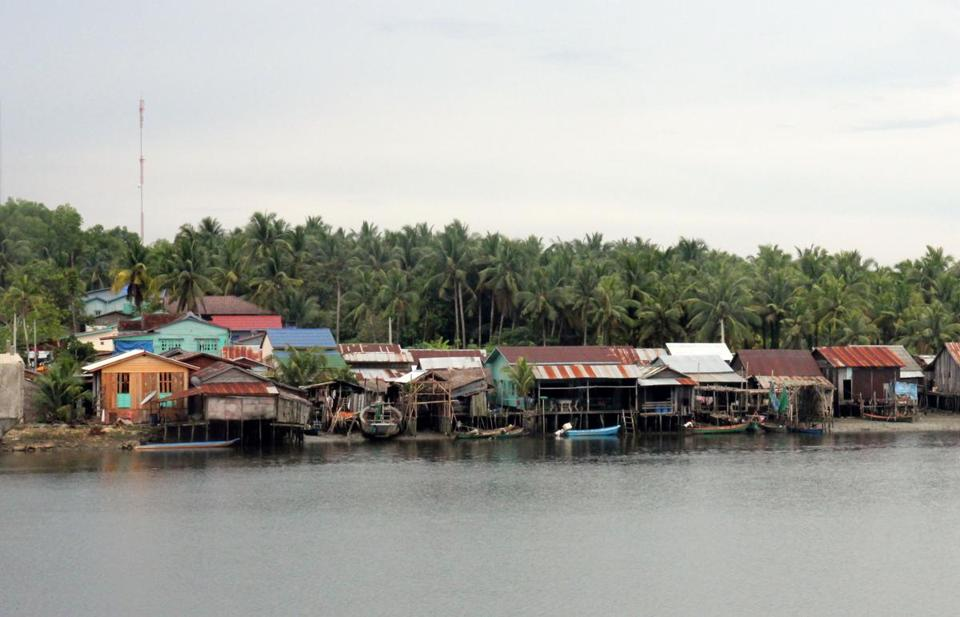 Houses line the Piphot River between the Cambodian villages of Chi Phat and Andoung Teuk. The province is trying to move toward a productive and more ecological economy.