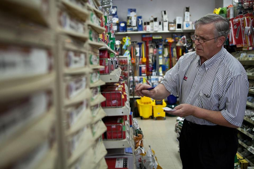 Roslindale, MA -- 06/20/12 -- Josef Porteleki checks on the stock in the Roslindale Hardware store, which he has owned for 45 years. Porteleki is 65 years old, and plans to work full-time until he is 70 years old in order to feel financially secure enough to retire. (Kayana Szymczak for the Boston Globe)