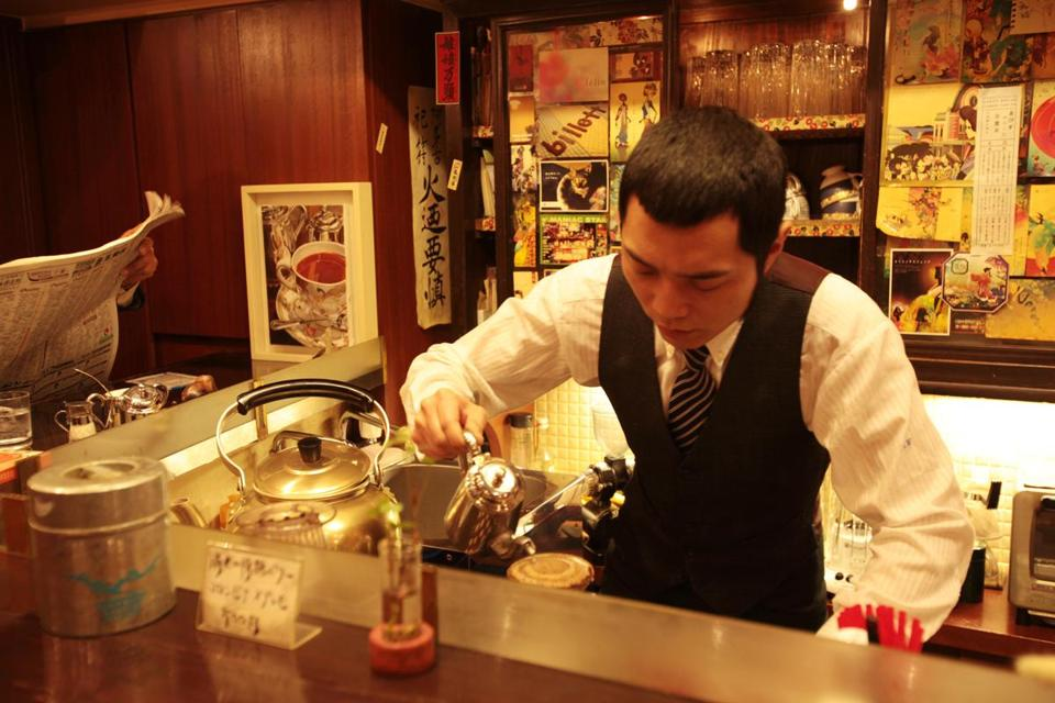 In his Otafuku Cafe in Kyoto, Noda-san makes pour-over coffee into a one-cup pot. Coffee came to Japan with European traders in the 16th and 17th centuries, and cafes have elegant brewing performances for devotees.