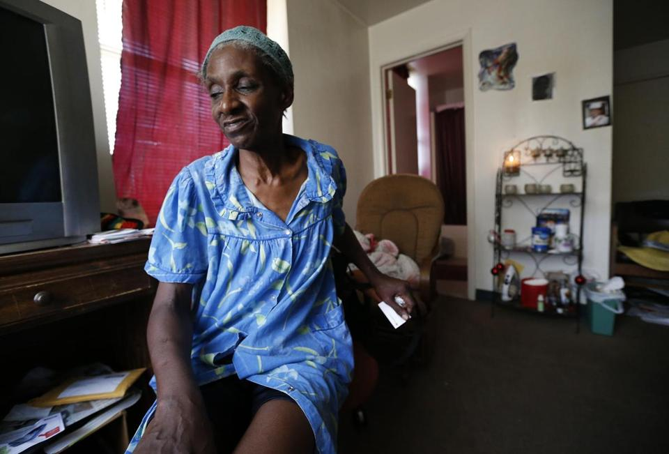 Janet Arnett sat in her apartment in Epiphany House, a low-income senior home in Baltimore, on Tuesday as she awaited return of electricity after last weekend's severe storms.