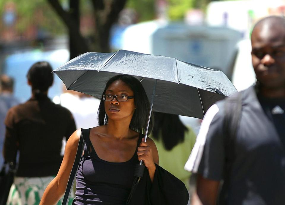 Josephine Adjei used an umbrella to protect herself from the sun.
