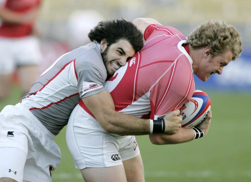 Nate Ebner (left) had a nose for the ball on both the rugby and football fields while at Ohio State.