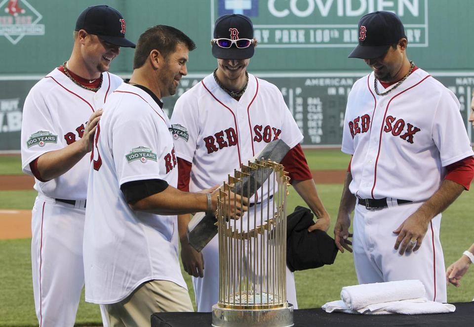 Pitchers (from left) Jon Lester, Clay Buchholz, and Josh Beckett present Jason Varitek with home plate from his final game during pregame ceremonies.