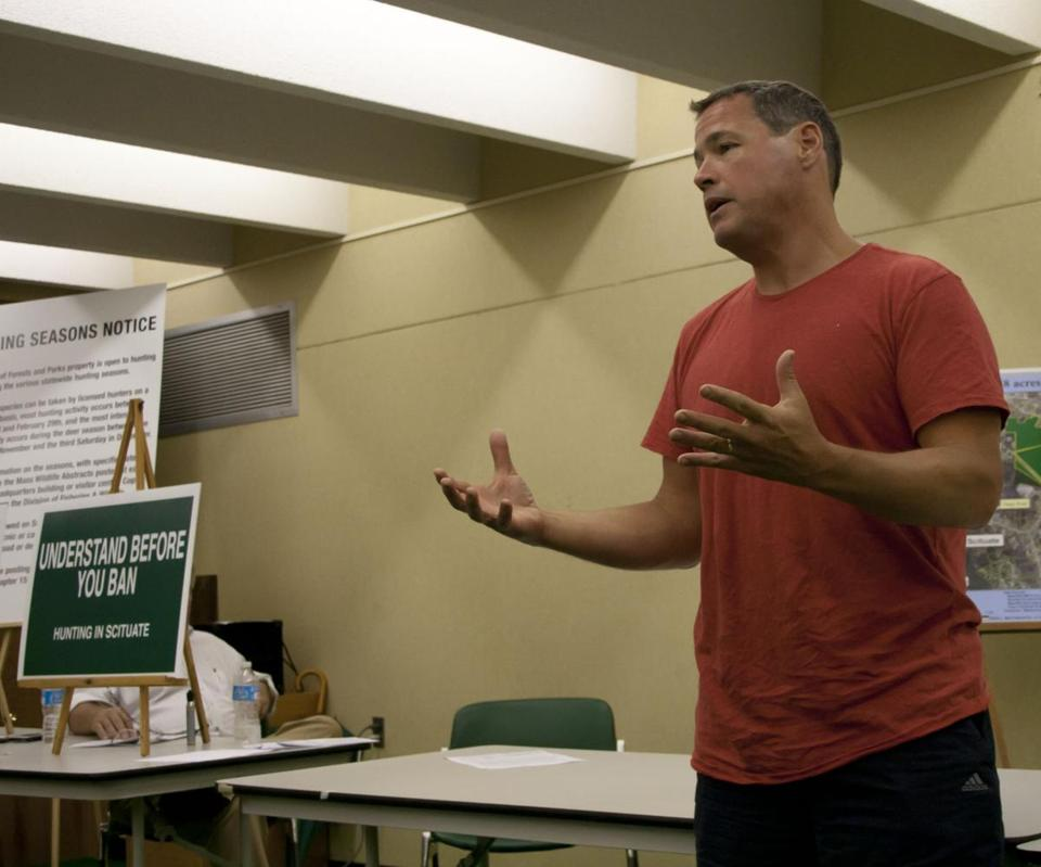 Jeff Corwin, TV personality and avid hunter, speaks at a public meeting in Scituate about keeping hunting regulations as they are on town-owned land.