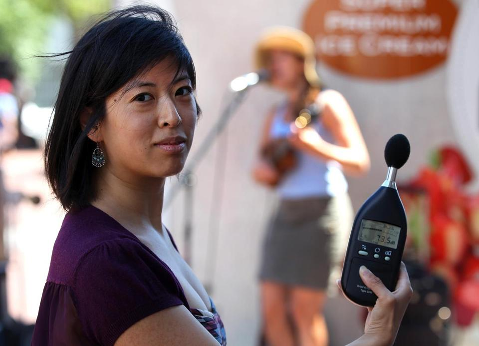 Leslie Condon holds the meter she uses to check sound levels of Harvard Square musicians.