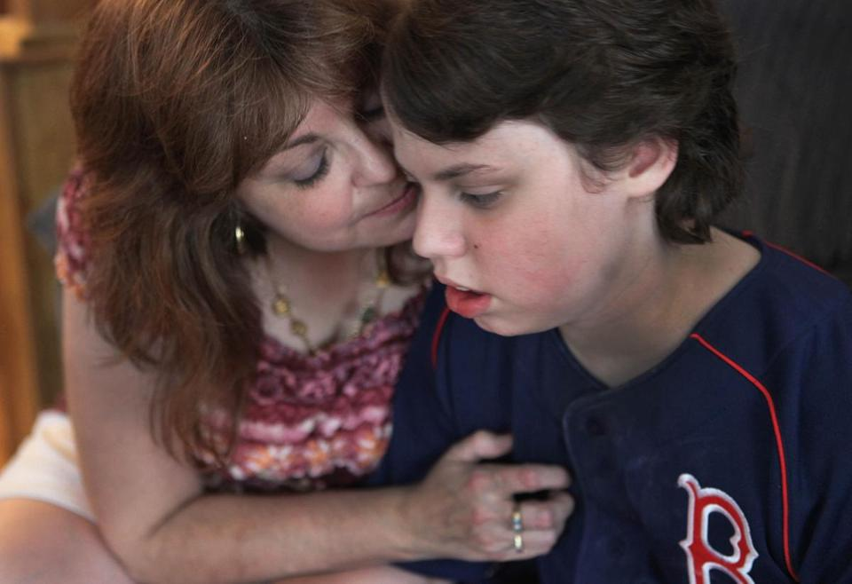 Brenda Manning with her son, Brian, 11, who recently underwent a hemispherectomy to try to stop his epileptic seizures.