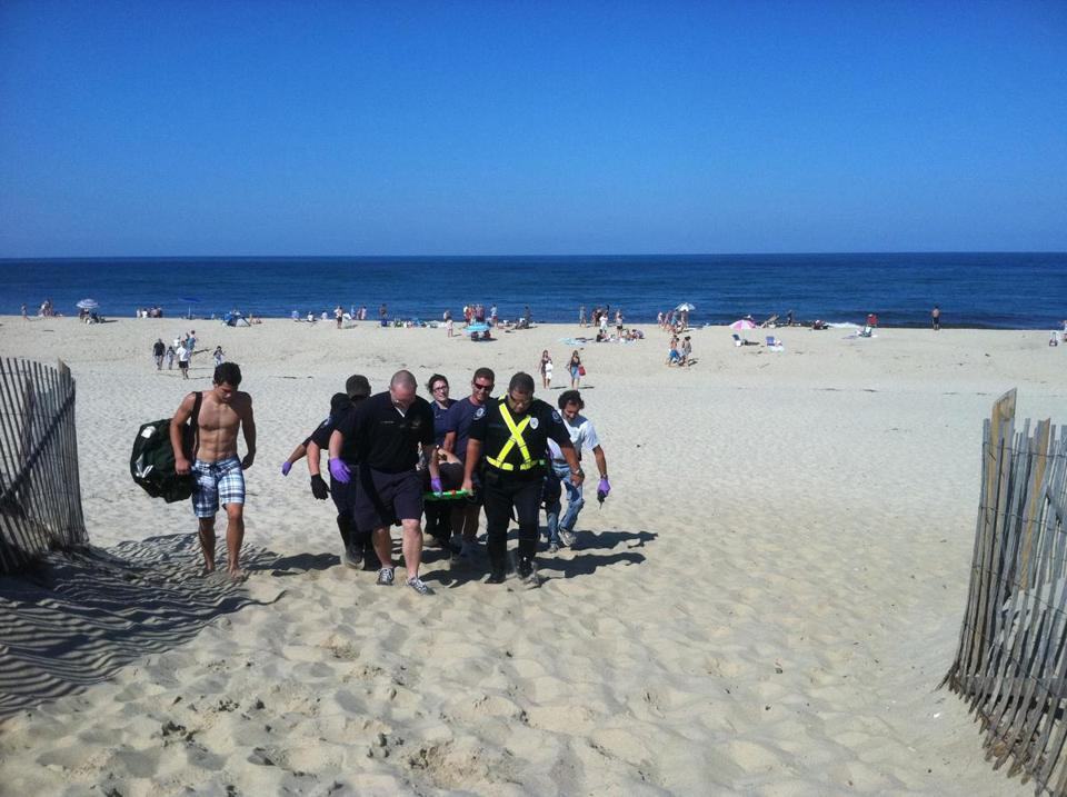 An Injured Man Was Carried Off Ton Beach In Truro Monday Cape Cod Times