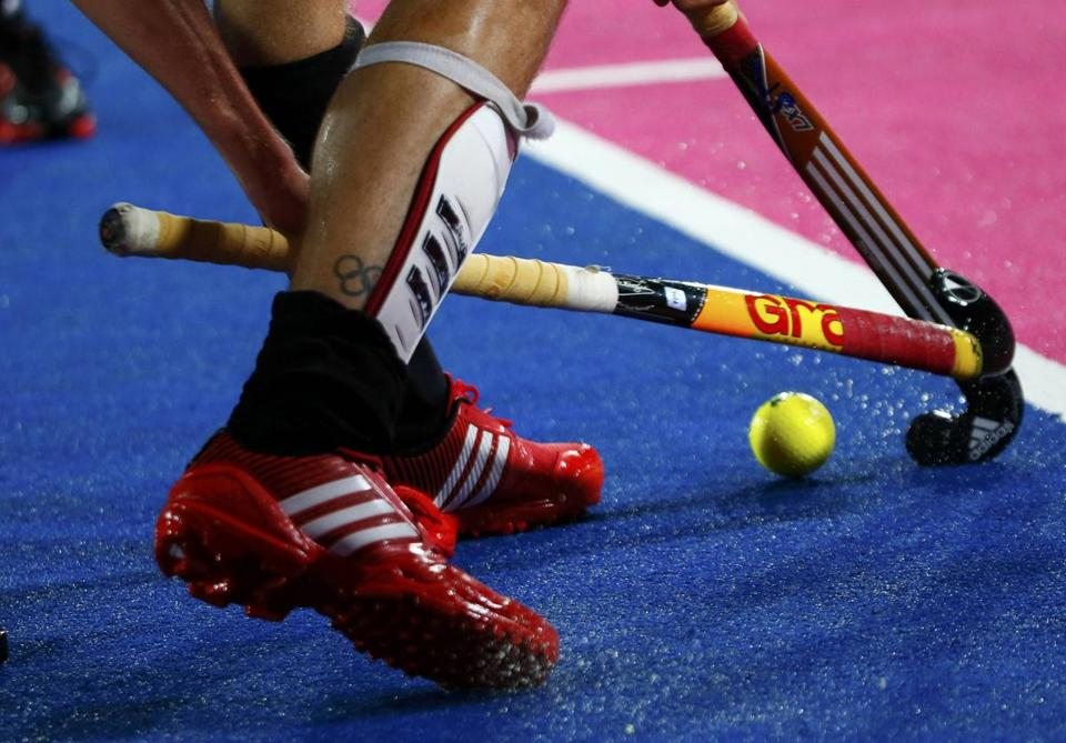 Germanys Mortiz Fuerste Competes On The Electric Blue Field Hockey Turf At Olympic Park